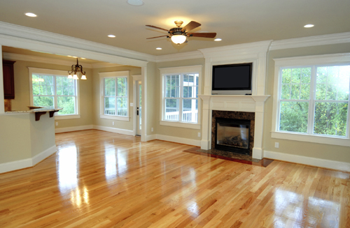 Spacious Room With Hardwood Flooring